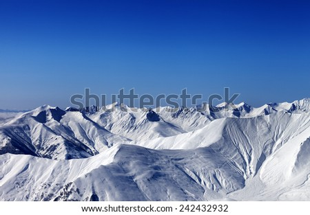 Winter snowy mountains with avalanche slope at evening. Caucasus Mountains, Georgia. Ski resort Gudauri.