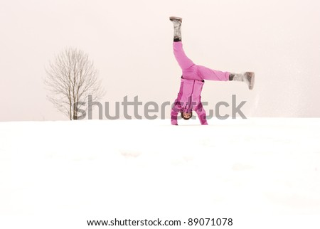 Winter sports exercises on the background of lone tree - stock photo