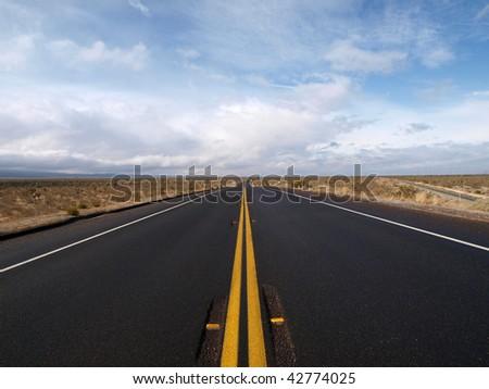 Winter storm sweeps across Pearblossom Highway in California's Mojave Desert.. - stock photo