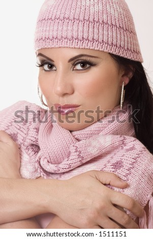 Winter Style - Beautiful female wearing knitted beanie and matching scarf.