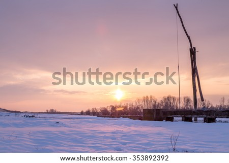 Winter sunrise at well