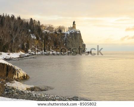 Winter sunrise on lake superior near the split rock lighthouse - stock photo