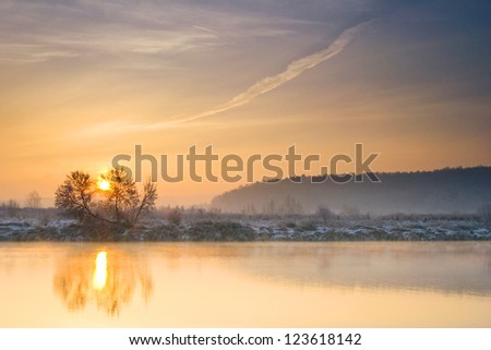 Winter sunrise over the river - stock photo