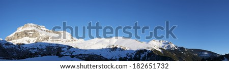 Winter sunset in the Pyrenees, left out the peak Bernera, Aragues Valley, Aragon, Huesca, Spain. - stock photo