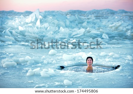 Winter swimming. Man in an ice-hole - stock photo
