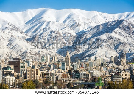 Winter Tehran  view with a snow covered Alborz Mountains on background - stock photo