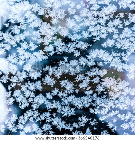 winter texture with frost pattern on frozen window - stock photo