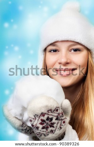 Winter. The beautiful girl. Game in snowballs. - stock photo