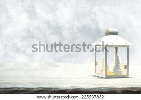 winter time and white lamp on white retro desk  - stock photo