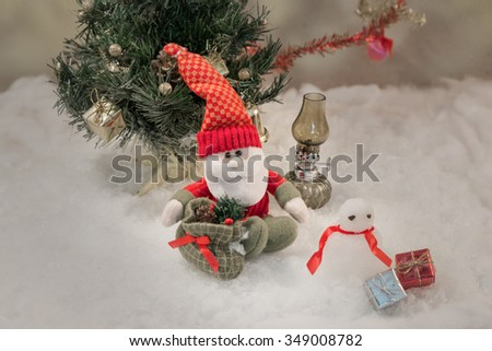 Winter time - doll of santa claus in nature in cold day,Christmas background with santa claus : vintage style - stock photo