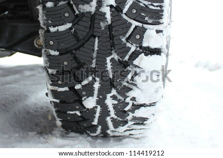 winter tire in snow closeup - stock photo
