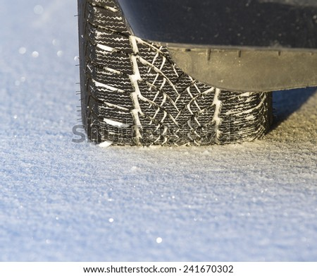 Winter tire on snow. - stock photo