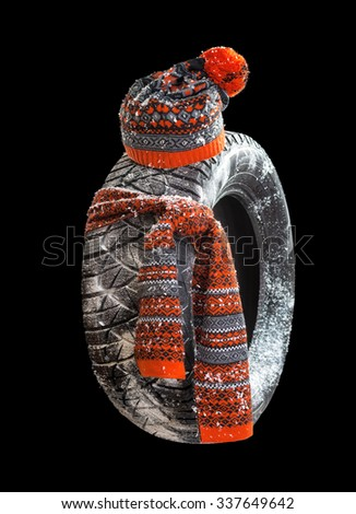 Winter tires with a warm scarf and a woolen cap. Isolated. - stock photo