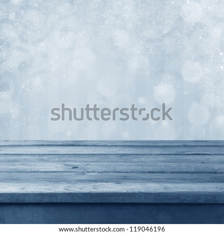Winter toned bokeh background with wooden table - stock photo