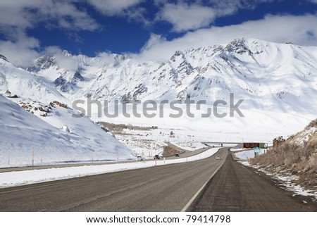 Winter travel on Highway 395 through the eastern Sierra Nevada mountains in California - stock photo