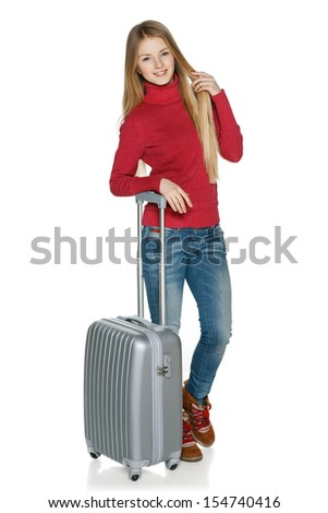 Winter traveler. Full length of young female in casual standing with the suitcase, isolated on white background - stock photo