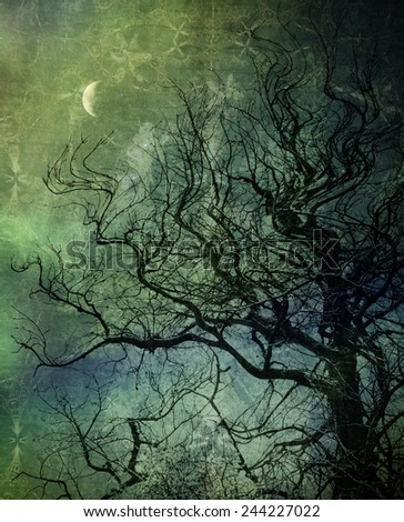Winter tree with crescent moon overlaid with textures for an artistic look. - stock photo