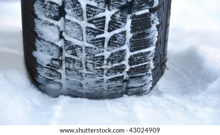 Winter tyre on the road - stock photo