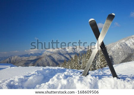 Winter vacation. Ski in the snow mountains. - stock photo