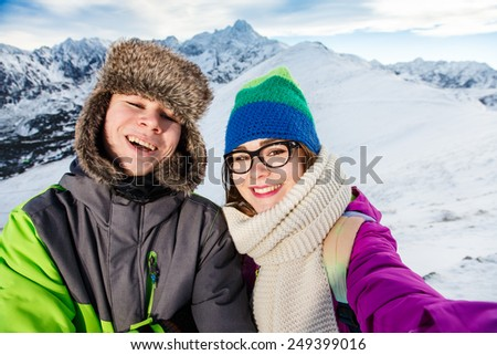 Winter vacation - teens in mountain - stock photo