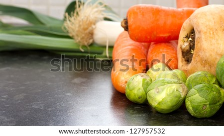 winter vegatables fresh and raw just picked in the kitchen - stock photo