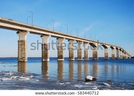 Winter view at the Oland Bridge in Sweden. The bridge is connecting the island Oland in the Baltic Sea with mainland Sweden