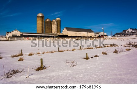 Winter view of a farm in rural Lancaster County, Pennsylvania. - stock photo