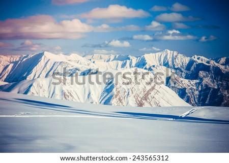 Winter view of Caucasus Mountains in Gudauri ski resort, Georgia. Toned picture - stock photo