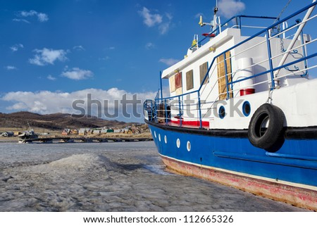 winter view of cutter at frozen baikal lake