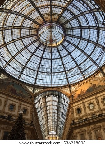 Winter view of Galleria Vittorio Emanuele II, Milan, Italy. Rooftop view of the Galleria Vittorio Emanuele II and the underlying palaces. 3 December 2015. Christmas Tree