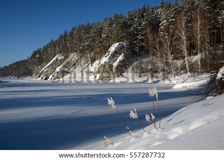 "Winter view of the cliff ""Hanging Rock"" on the shores of icy Chusovaya river."