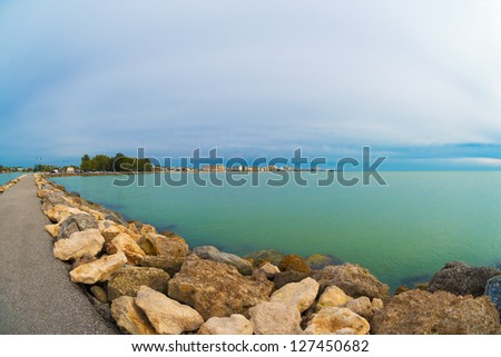 Winter view of Venice on the Gulf of Mexico, as seen from the end of the South Jetty in Venice, Florida. - stock photo