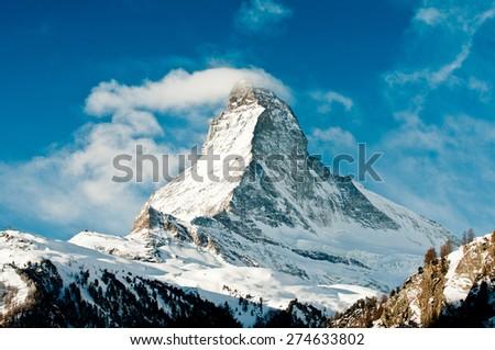 Winter view on snowy Matterhorn from Zermatt village, Switzerland - stock photo