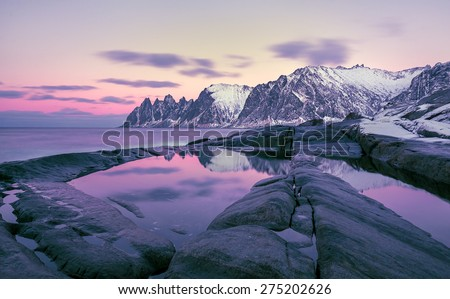 Winter view to the Steinfjord on Senja Island in the sunset, Oksan on background -  Troms county, Norway (long exposure)  - stock photo