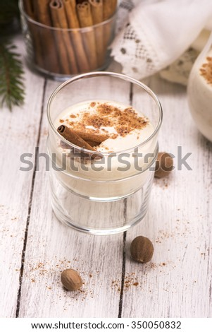 Winter warm milk drink eggnog with cinnamon and nutmeg. Selective focus