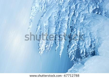 Winter waterfall framed by ice, Comstock Creek, Michigan, USA - stock photo