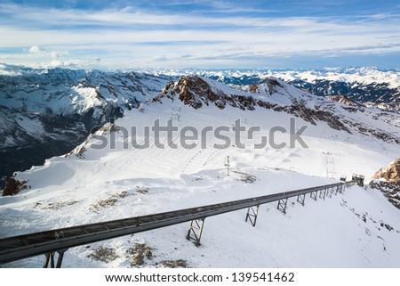 Winter with ski slopes of kaprun resort next to kitzsteinhorn peak in austrian alps - stock photo
