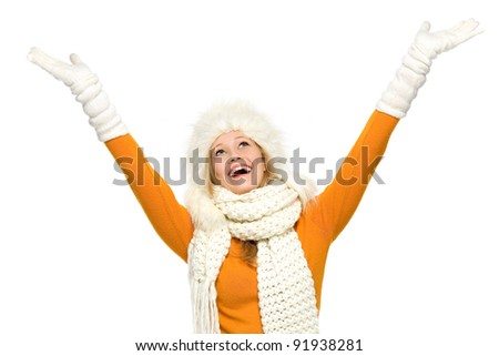 Winter woman with arms raised - stock photo