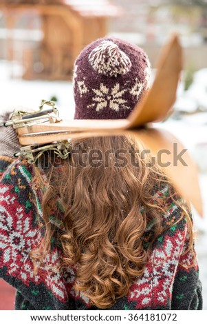 Winter woman with retro ski, focus on woman - stock photo