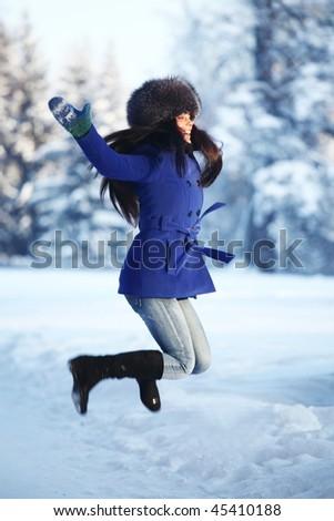 winter women jump in snow - stock photo
