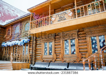 winter wooden Russian style house where Father Frost lives - stock photo
