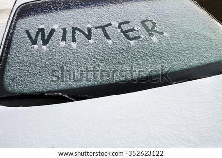 Winter written on a car's front windshield - stock photo
