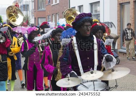 WINTERSWIJK, HOLLAND  16 NOVEMBER 2013: Santa Claus (Sinterklaas and Zwarte Piet) arriving  in Winterswijk, The Netherlands - stock photo