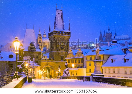 wintertime Charles bridge, gothic Lesser Town bridge tower, Lesser town district, Prague (UNESCO), Czech republic, Europe - stock photo