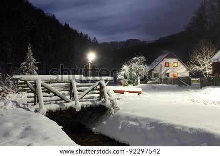 Wintry landscape with chalet. - stock photo