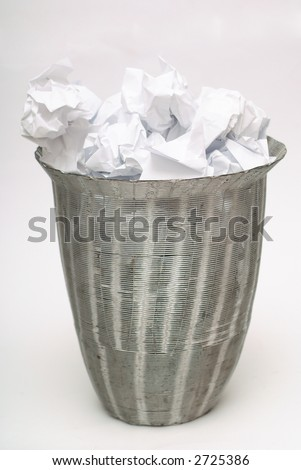 Wire business dustbin or wastepaper basket on white with paper trash