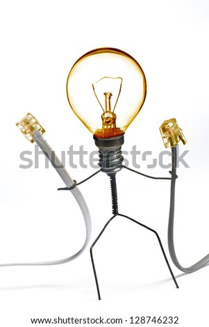 Wire character holding two cables illustrating network idea - stock photo