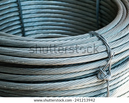 wire - coil cable fiber optic technology mechanical closeup - stock photo