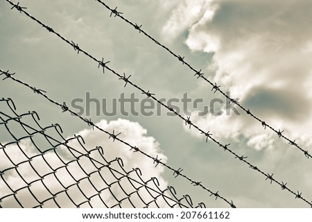 wire fence in the sky background - stock photo