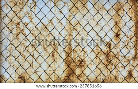 rusty chain link fence texture. wire mesh fence on a very rusty surface chain link texture t